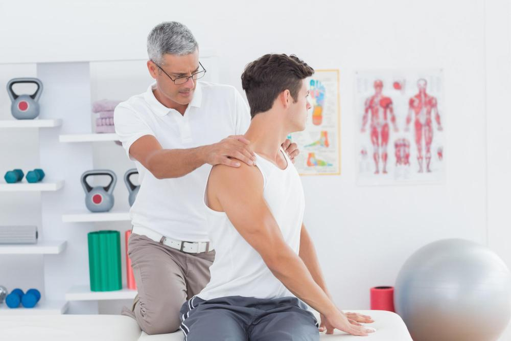 man giving chiropractic adjustment